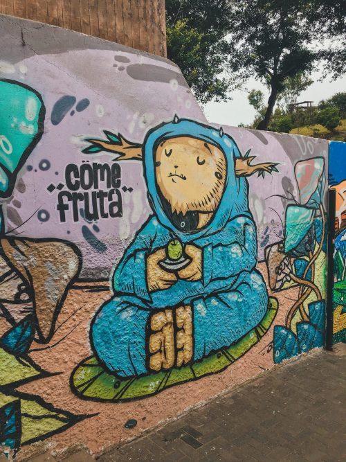Budda trzymający jabłko graffiti