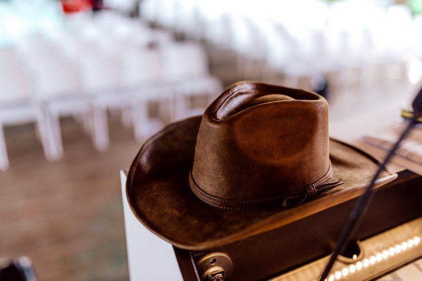 A cowboy hat on a lectern