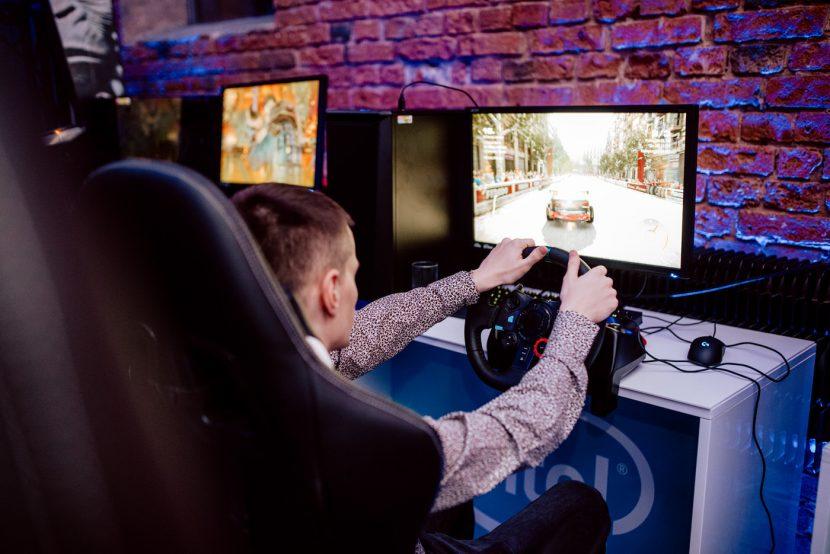 boy plays logitech steering wheel in grid 2