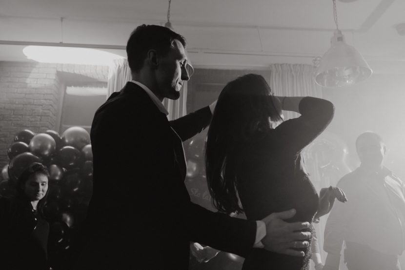 Couple on the dance floor in the smoke