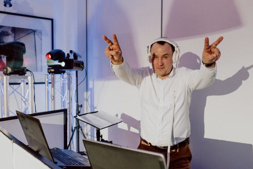 DJ in white headphones poses for a photo
