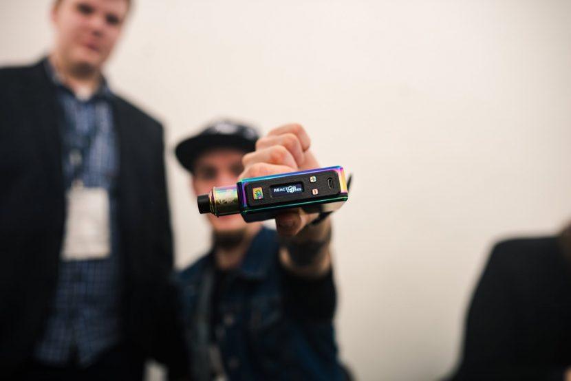 vaper holds e-cigarette