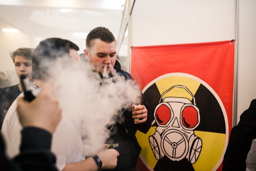 A poster with a gas mask and a boy blowing smoke from his nose