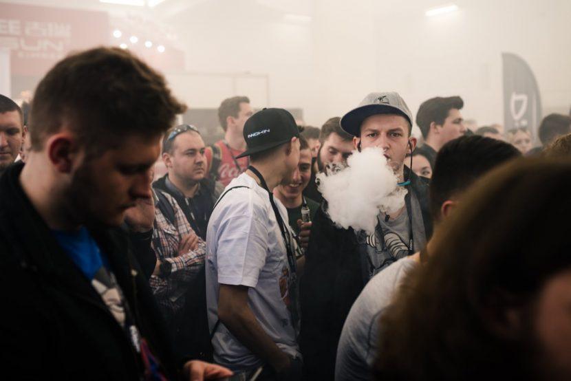 The boy in the cap emits white smoke