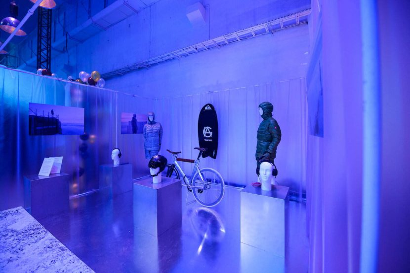 exhibition of clothes, headphones and bicycle in blue light in rainbow studio